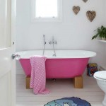 bathroom with pink bathtub