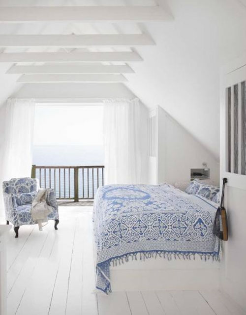 Minimalist white bedroom with scant blue accents, via Panda's House