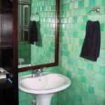green cabo glass bathroom