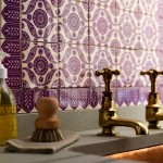 brass faucets with purple Moroccan tiles