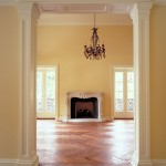 herringbone floors, fireplace and yellow walls