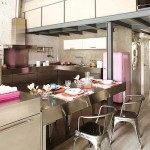 pink kitchen with steel appliances