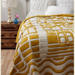Bedspread in white and mustard yellow