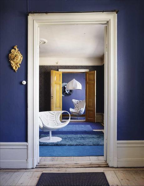 blue interior design with blue walls and rugs