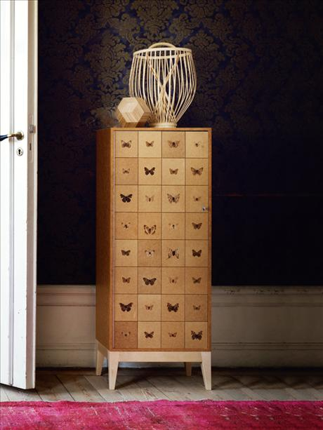 blonde wood cabinet with butterfly motifs