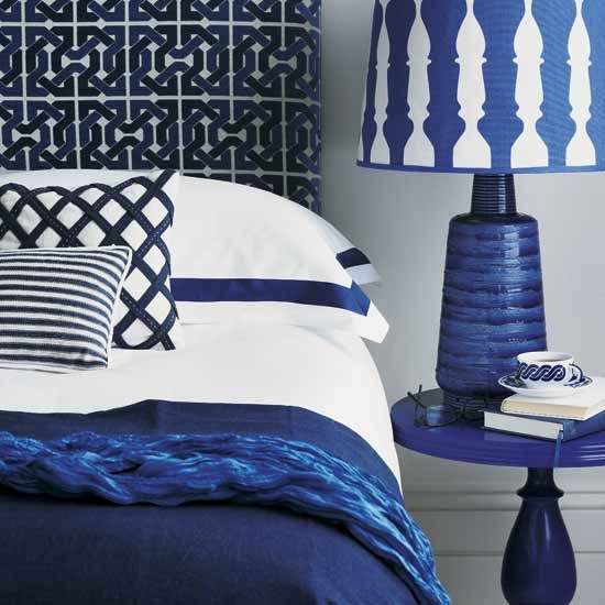 navy blue bedroom with patterns