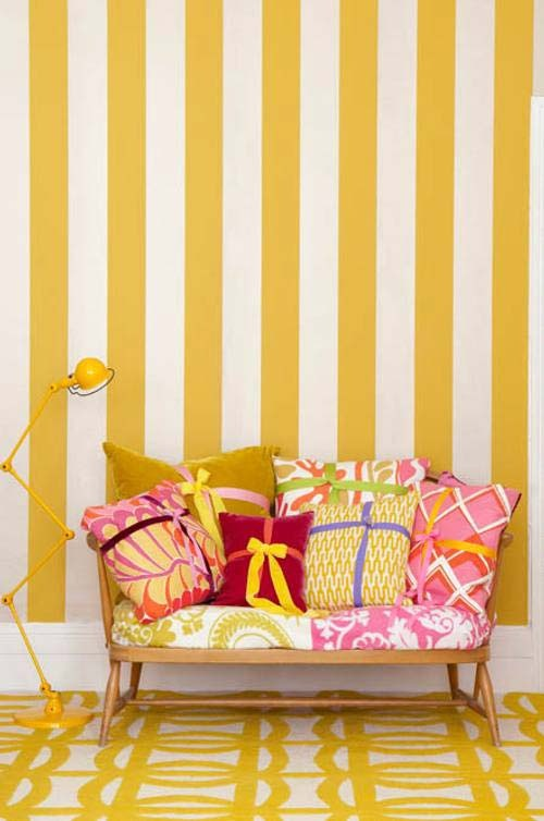 yellow stripes and pink cushions