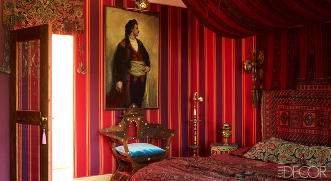 Bohemian red and purple guestroom dressed in Indian cashmere.