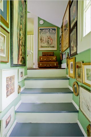 green stairway with art