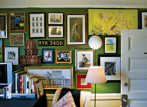 green walls packed with pictures