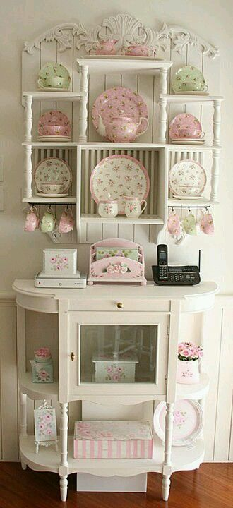 white cabinet with pink and green vintage items