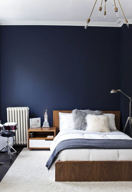 besroom  deep denim blue and warm timber tones