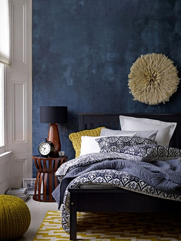 deep blue accent wall in modern eclectic bedroom