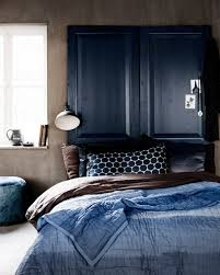 indigo blue bedroom, doors as headboard