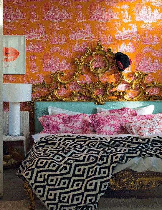 pink toile wallpaper ornate gold bed frame and bedding orange pink